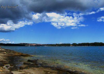 Premantura, obala in oblaki